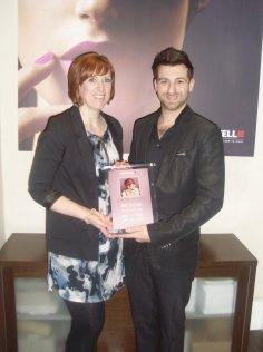 Paul Francis is presented her diploma by Rachel Hurley of Goldwell
